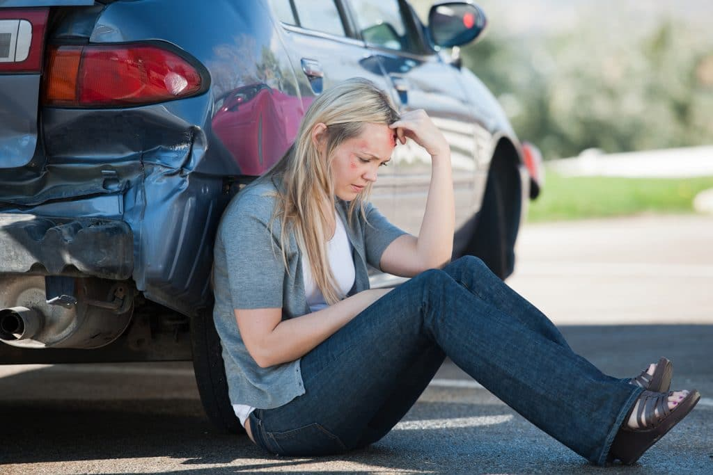 Accident Victim Waits Outside of Her Car